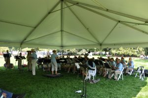 Battle Creek Cereal City Band performs under tent at Lakeside Concert