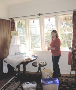 An artist preps her space with items for the Holiday Walk and Market