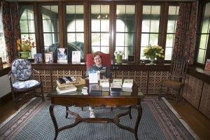 Docents are ready to greet guests into the library of the W.K. Kellogg Manor House