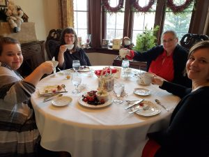 Guests enjoy tea service in the Manor House
