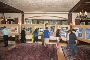 Visitors enjoy WWII displays in the Manor House living room