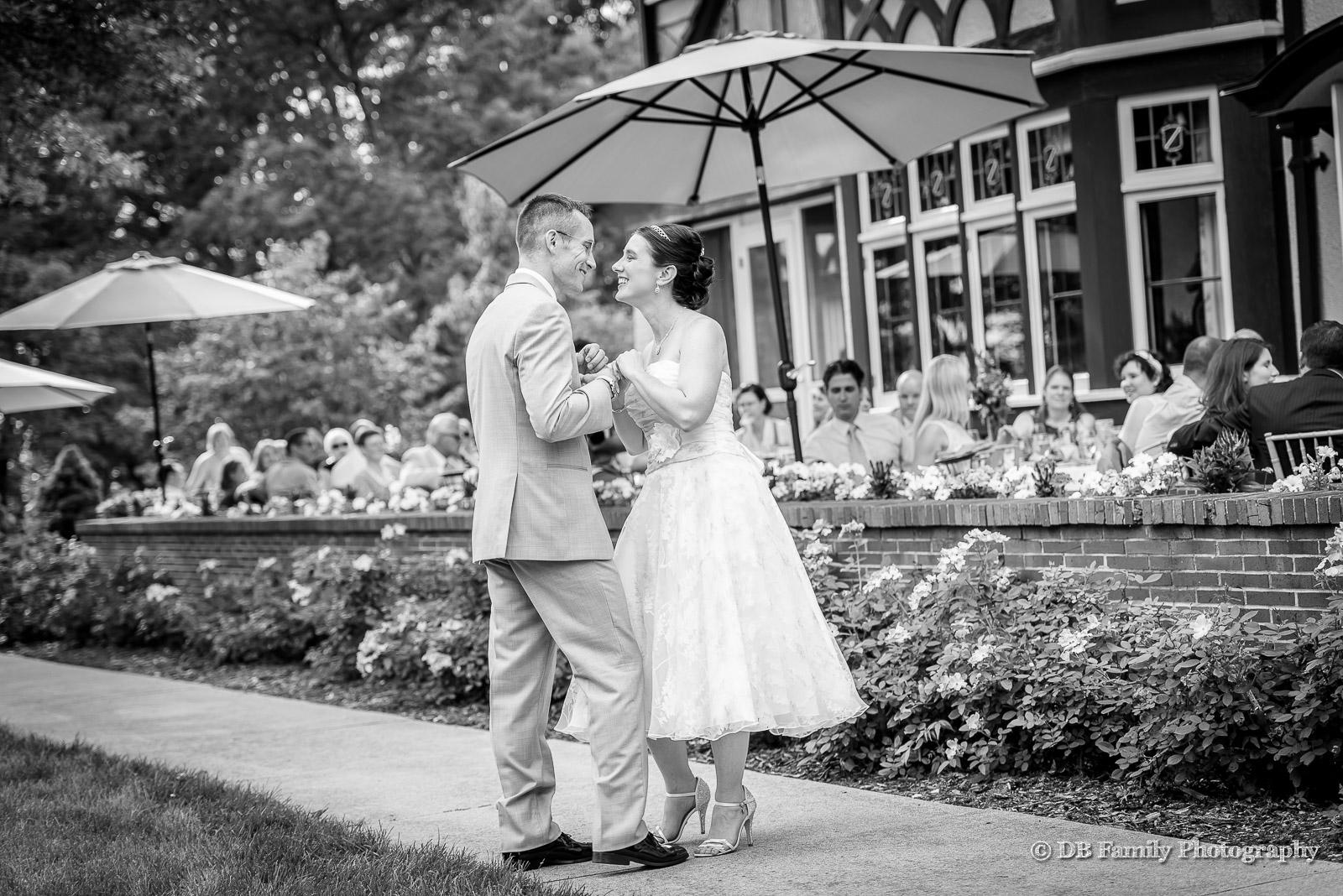 Bride and groom dancing on terrace