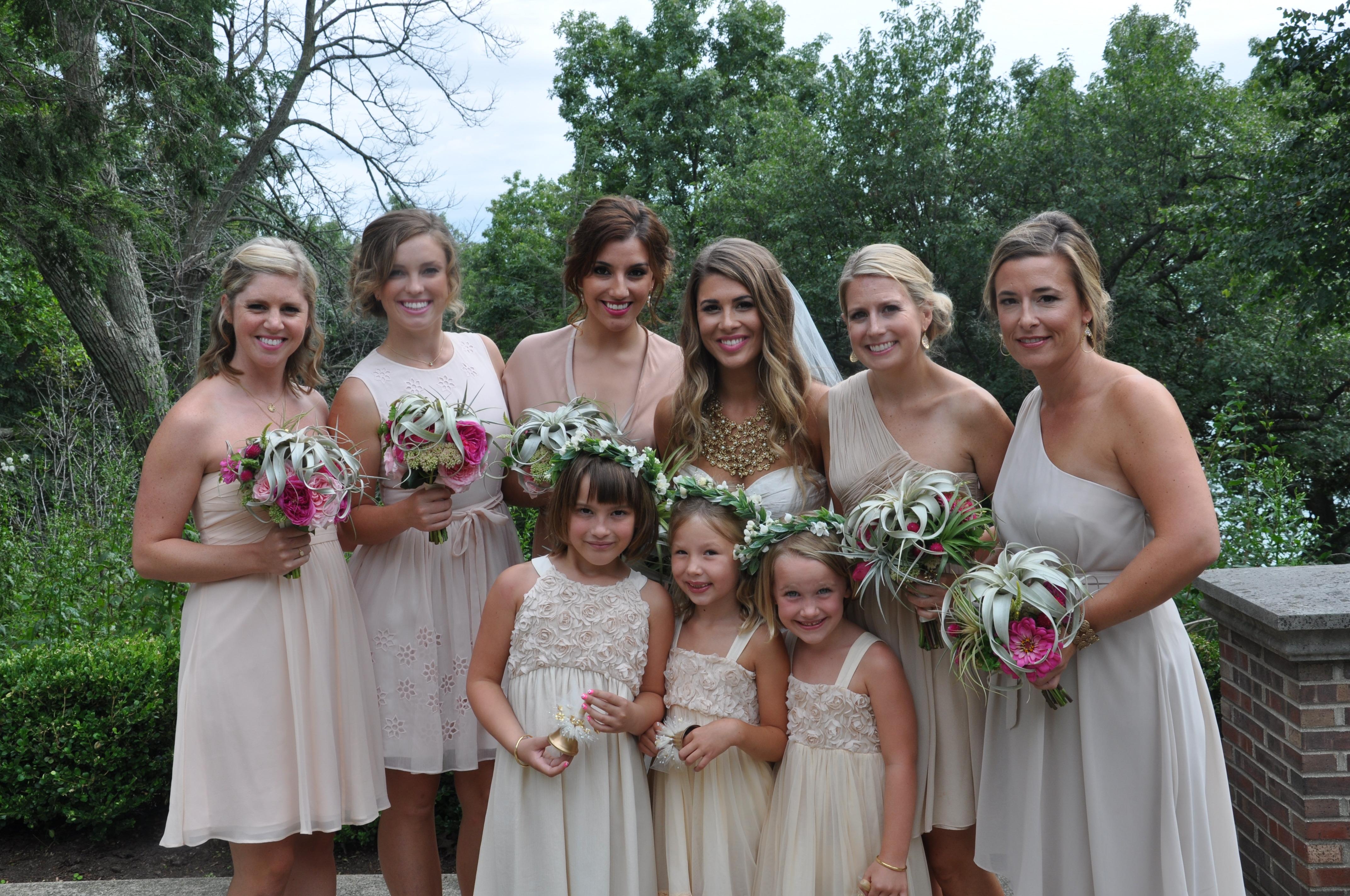 Bridesmaids in reflection pool garden