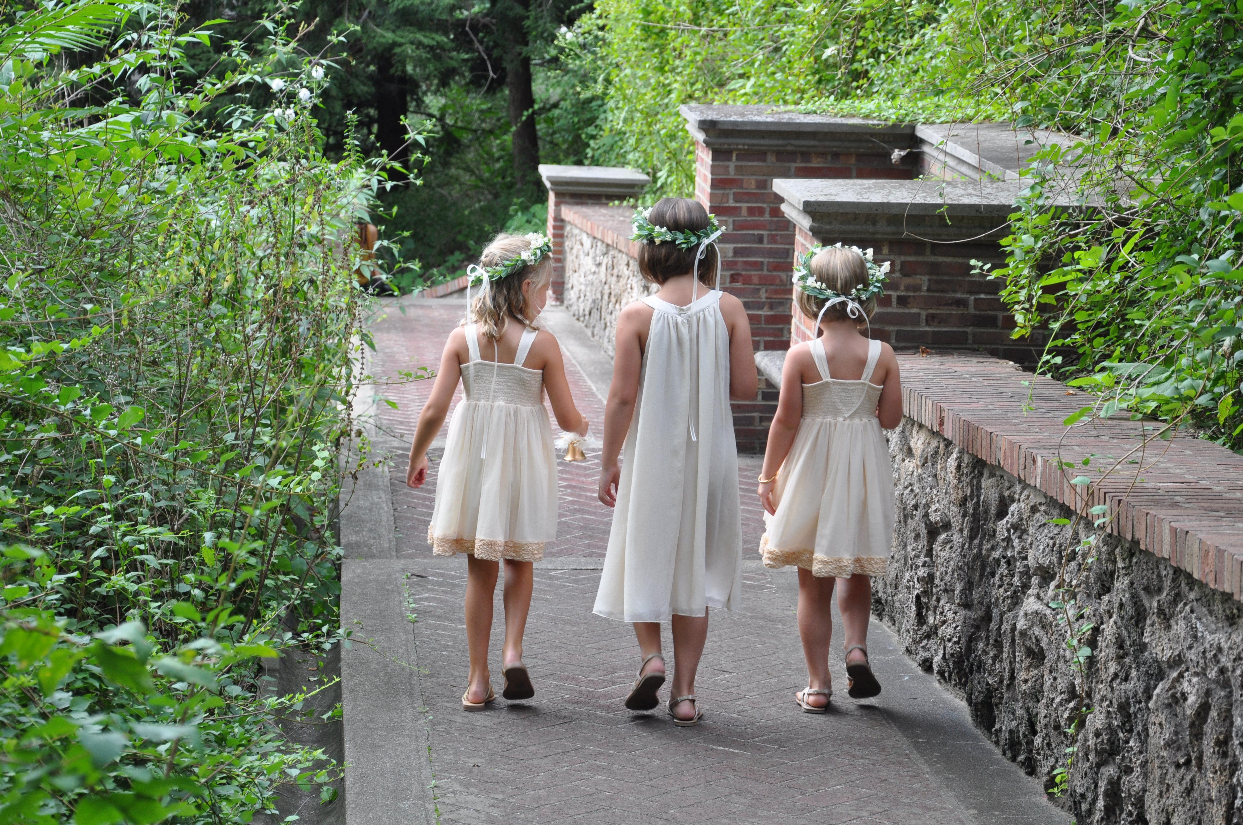 Flower girls walking down isle